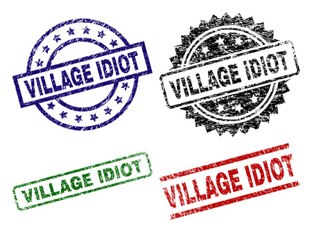 VILLAGE IDIOT seal prints with corroded style. Black, green,red,blue vector rubber prints of VILLAGE IDIOT title with corroded texture. Rubber seals with round, rectangle, medal shapes.