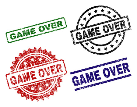 GAME OVER seal prints with corroded surface. Black, green,red,blue vector rubber prints of GAME OVER title with corroded surface. Rubber seals with circle, rectangle, medallion shapes.