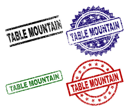 TABLE MOUNTAIN seal prints with corroded surface. Black, green,red,blue vector rubber prints of TABLE MOUNTAIN caption with corroded surface. Rubber seals with circle, rectangle, rosette shapes.