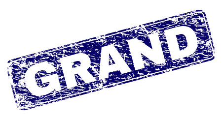 GRAND stamp seal print with distress texture. Seal shape is a rounded rectangle with frame. Blue vector rubber print of GRAND caption with dust texture.