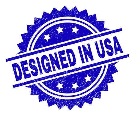 DESIGNED IN USA stamp seal watermark with distress style. Blue vector rubber print of DESIGNED IN USA text with corroded texture.