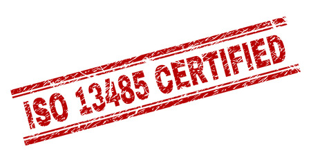 ISO 13485 CERTIFIED seal print with corroded effect. Red vector rubber print of ISO 13485 CERTIFIED tag with corroded texture. Text label is placed between double parallel lines.