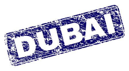 DUBAI stamp seal print with distress style. Seal shape is a rounded rectangle with frame. Blue vector rubber print of DUBAI text with dirty style.