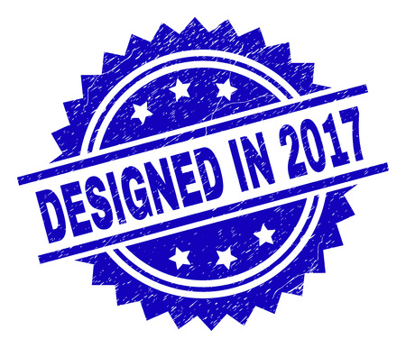 DESIGNED IN 2017 stamp seal watermark with distress style. Blue vector rubber print of DESIGNED IN 2017 tag with grunge texture.