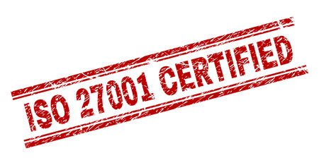 ISO 27001 CERTIFIED seal print with corroded style. Red vector rubber print of ISO 27001 CERTIFIED text with corroded texture. Text label is placed between double parallel lines.