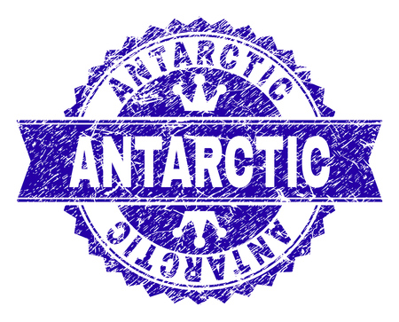 ANTARCTIC rosette stamp watermark with distress style. Designed with round rosette, ribbon and small crowns. Blue vector rubber watermark of ANTARCTIC label with dirty style. 写真素材 - 127209279
