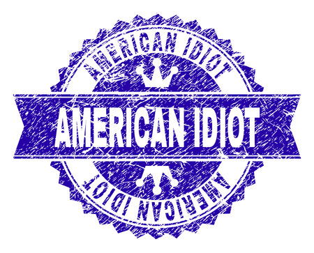 AMERICAN IDIOT rosette stamp imprint with grunge style. Designed with round rosette, ribbon and small crowns. Blue vector rubber watermark of AMERICAN IDIOT text with unclean style.