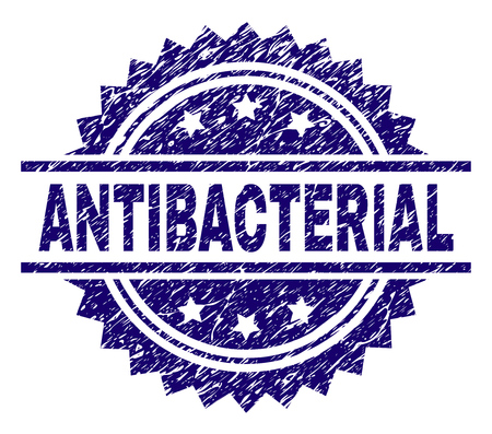 ANTIBACTERIAL stamp seal watermark with distress style. Blue vector rubber print of ANTIBACTERIAL text with retro texture.