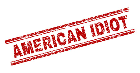 AMERICAN IDIOT seal print with grunge texture. Red vector rubber print of AMERICAN IDIOT label with corroded texture. Text caption is placed between double parallel lines. Illusztráció