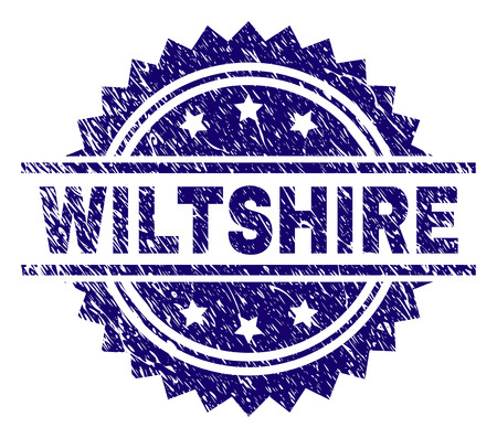WILTSHIRE stamp seal watermark with distress style. Blue vector rubber print of WILTSHIRE text with corroded texture.