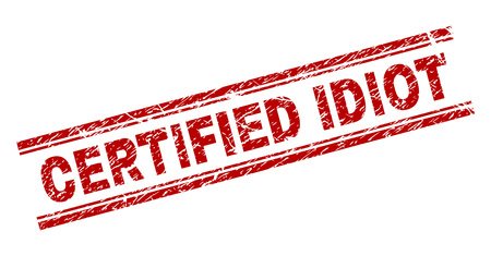 CERTIFIED IDIOT seal print with corroded texture. Red vector rubber print of CERTIFIED IDIOT title with corroded texture. Text caption is placed between double parallel lines.