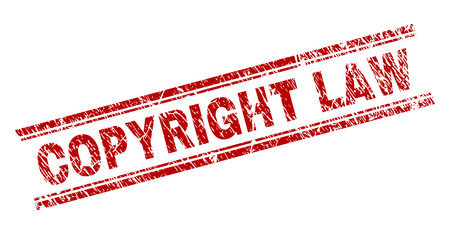 COPYRIGHT LAW seal watermark with distress style. Red vector rubber print of COPYRIGHT LAW tag with grunge texture. Text tag is placed between double parallel lines.