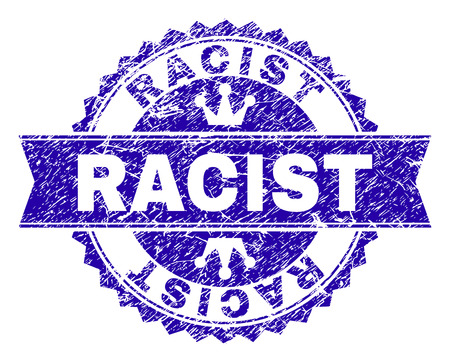 RACIST rosette stamp seal watermark with distress texture. Designed with round rosette, ribbon and small crowns. Blue vector rubber watermark of RACIST caption with retro texture.