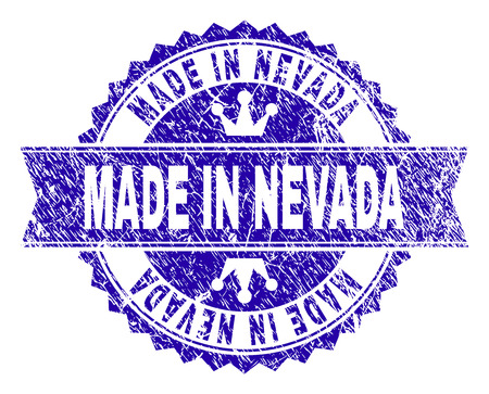 MADE IN NEVADA rosette stamp watermark with grunge style. Designed with round rosette, ribbon and small crowns. Blue vector rubber watermark of MADE IN NEVADA text with grunge texture.