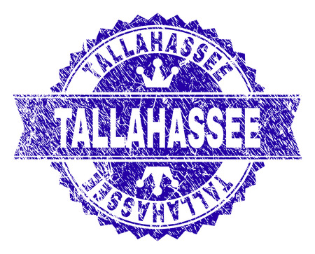 TALLAHASSEE rosette stamp seal imitation with distress style. Designed with round rosette, ribbon and small crowns. Blue vector rubber watermark of TALLAHASSEE caption with dust style. Illustration