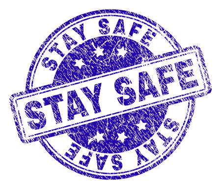STAY SAFE stamp seal imprint with grunge texture. Designed with rounded rectangles and circles. Blue vector rubber print of STAY SAFE tag with dirty texture.