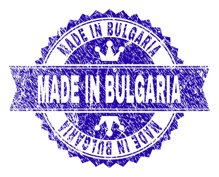 MADE IN BULGARIA rosette stamp seal watermark with grunge effect. Designed with round rosette, ribbon and small crowns. Blue vector rubber print of MADE IN BULGARIA caption with grunge texture. 向量圖像