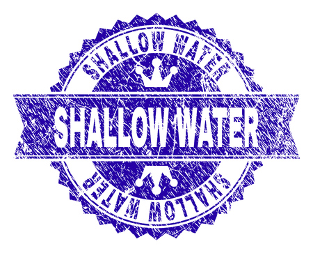 SHALLOW WATER rosette seal imitation with distress texture. Designed with round rosette, ribbon and small crowns. Blue vector rubber print of SHALLOW WATER title with unclean texture.