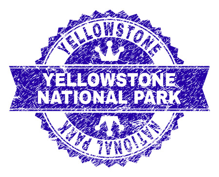 YELLOWSTONE NATIONAL PARK rosette stamp imprint with distress texture. Designed with round rosette, ribbon and small crowns. Illustration