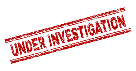UNDER INVESTIGATION seal imprint with distress texture. Red vector rubber print of UNDER INVESTIGATION text with unclean texture. Text caption is placed between double parallel lines.