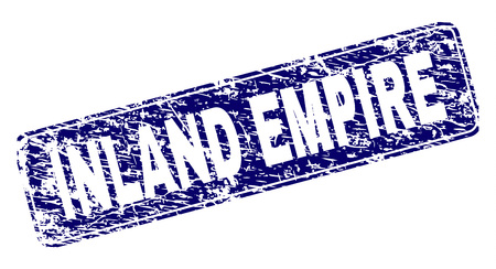INLAND EMPIRE stamp seal print with distress texture. Seal shape is a rounded rectangle with frame. Blue vector rubber print of INLAND EMPIRE label with dust texture.