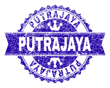 PUTRAJAYA rosette stamp seal overlay with distress texture. Designed with round rosette, ribbon and small crowns. Blue vector rubber print of PUTRAJAYA tag with dust texture.
