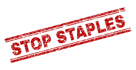 STOP STAPLES seal print with distress effect. Red vector rubber print of STOP STAPLES caption with dust texture. Text caption is placed between double parallel lines.