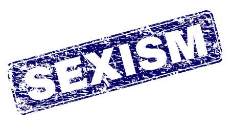 SEXISM stamp seal print with distress style. Seal shape is a rounded rectangle with frame. Blue vector rubber print of SEXISM tag with scratched style.