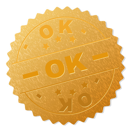 OK gold stamp award. Vector golden award with OK text. Text labels are placed between parallel lines and on circle. Golden skin has metallic structure.