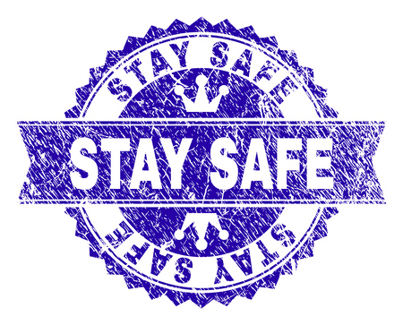 STAY SAFE rosette seal watermark with distress texture. Designed with round rosette, ribbon and small crowns. Blue vector rubber watermark of STAY SAFE label with retro texture.