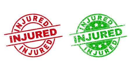 Round INJURED stamps. Flat vector scratched seal stamps with INJURED caption inside circle and lines, using red and green colors. Watermarks with scratched texture.