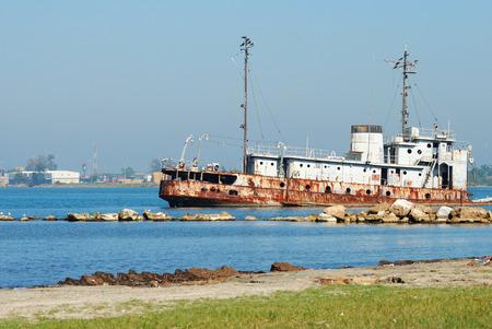 Ship wreck on beach at Porto Cortes, Honduras