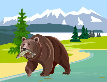Bear with fish in his mouth against the background of mountains.