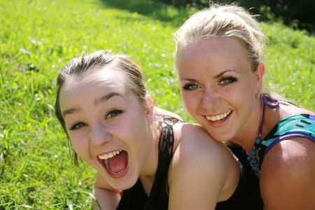 two smiling young girls in summer, very happy photo