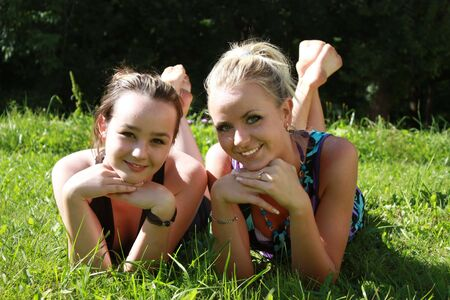 two smiling young girls in summer photo