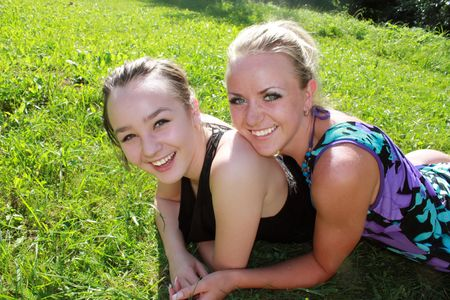 Two beautiful girls on the grass
