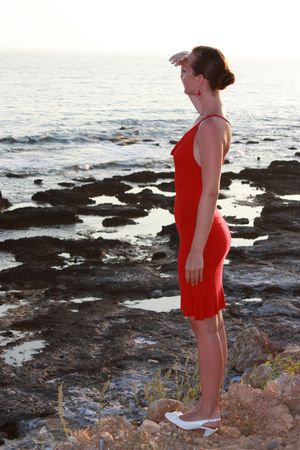 young woman in red dress looks into a future Stock Photo - 5608561