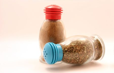 TWO BOTTLES WITH SPICE ISOLATED ON THE WHITE Stock Photo - 5639903
