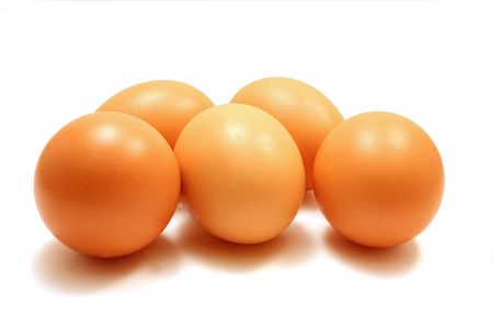 Five eggs, isolated on a white background.