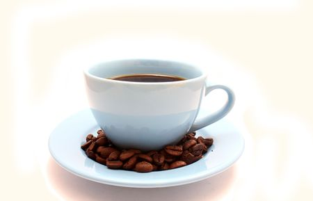 blue cup of coffee with grains on white background