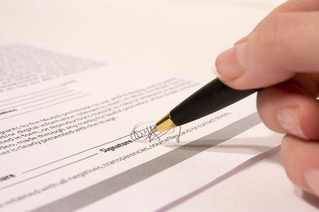 female hand holding pen on white background