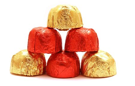 foil: Pyramid of chocolate sweet isolated on white
