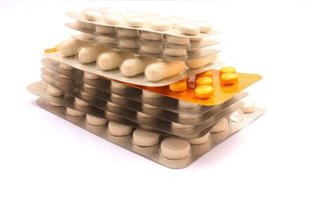 Pile of pills in a blister isolated on white background