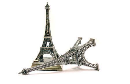 figurines: EIFFEL TOWERS FIGURINES ISOLATED ON WHITE Stock Photo