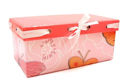 A pink gift box on white isolated
