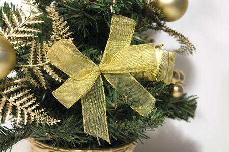 Closeup gold ribbon on christmas tree