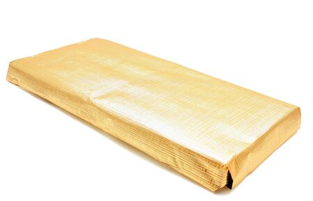 wrapped up: CHOCOLATE IN FOIL ISOLATED ON WHITE BACKGROUND