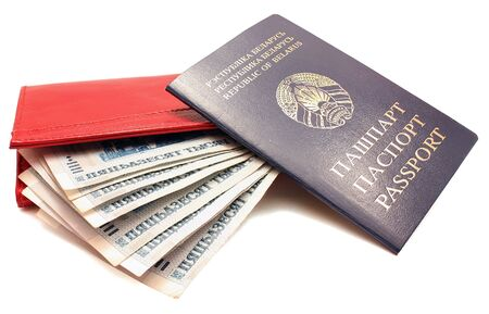 Female red purse with money and passport isolated on white background