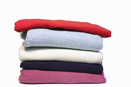 Pile of colour clothes isolated on white