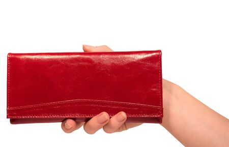 Female hand holding beautiful red purse isolated on white